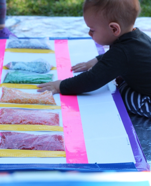 Sensory Boxes with Rice for Babies and Toddlers - What to do with a cardboard Box